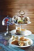 picture of tea party  - A serving bowl with sweets and cookies for a high tea