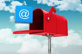 pic of postbox  - Red email postbox against blue sky - JPG