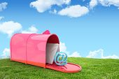 picture of postbox  - Red email postbox against field and sky - JPG