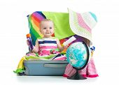 stock photo of baby toddler  - Baby girl sitting in suitcase with  things for vacation travel isolated - JPG