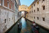 picture of gondola  - Gondolas passing under Bridge of Sighs - JPG