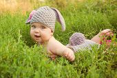 foto of baby easter  - Easter bunny baby in green grass meadow - JPG