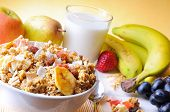 stock photo of fruit bowl  - Bowl of cereal with fruit on a white wooden table and fresh fruits behind top diagonal composition - JPG