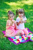picture of tease  - Girls kids sisters friends teasing eating ice cream focus on younger girl - JPG
