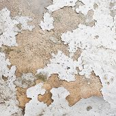 stock photo of fragmentation  - Whitewash falling off the wall fragment as a background grunge texture - JPG