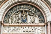 foto of building relief  - relief above the portal Baptistery of Parma Italy - JPG