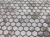 stock photo of paving stone  - Urban road is paved with blocks of stone cobblestone walkway - JPG