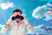 image of binoculars  - Positive businessman using binoculars against stocks and shares on black background - JPG