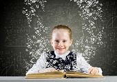 foto of sketch book  - Schoolgirl with opened book against sketch background - JPG