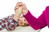 stock photo of wrestling  - Adult arm wrestling with young girl - JPG