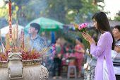 picture of buddhist  - Vietnamese girl praying in Buddhist temple - JPG