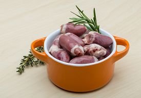 picture of giblets  - Raw chicken hearts with thyme and rosemary - ready for cooking ** Note: Shallow depth of field - JPG