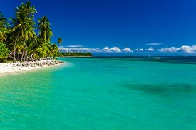 foto of jetties  - Tropical island in Fiji with sandy beach and pristine water - JPG