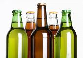 image of liquor bottle  - bottles of beer against a white background - JPG