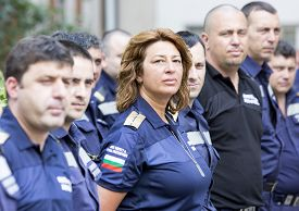 stock photo of firefighter  - Sofia Bulgaria - July 15 2015: A woman firefighter is standing among her colleagues in a line during a awards ceremony. ** Note: Soft Focus at 100%, best at smaller sizes - JPG