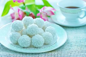 stock photo of laddu  - coconut balls on the white plate and on a table