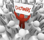 A red person stands out in a crowd holding a sign reading Customers, symbolizing the targeting of co