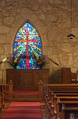 Church Interior With Sunlit Stained Glass Window
