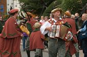 ABBOTS BROMLEY, STAFFORDSHIRE, UK - SEPT 8: The Melodian Player leads the parade of the annual ceremonial Horn Dance on 'Wakes Monday', September 8 2008, Abbots Bromley, Staffordshire, UK