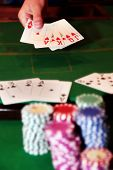 Poker Player Showing Unbeatable Royal Flush