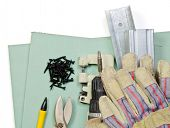 Plasterboard tools set with metal studs, screws, screwgun, punch lock crimper, tin snip cutter and p