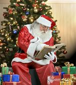 stock photo of santa-claus  - A real Santa Claus portrait checking his list - JPG