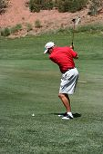 Male About To Hit Ball From The Fairway, Focus On Golfer