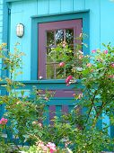 Teal Cottage With Roses