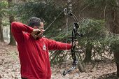 Man Aiming With A Technological Bow