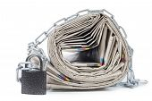 pile of newspapers with chains