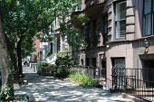 stock photo of brownstone  - New York City Manhattan neighborhood street scene - JPG