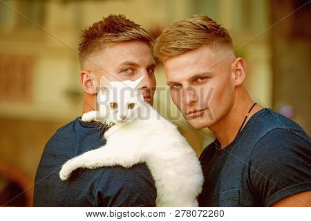 poster of Perfect Furry Friend. Cat Is A Part Of Their Family. Muscular Men With Cute Cat. Happy Cat Owners On