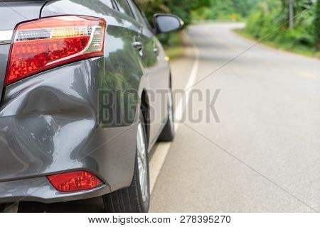 poster of Back Of Gray Car Get Damaged From Accident On The Road. Vehicle Bumper Dent Broken By Car Crash. Roa