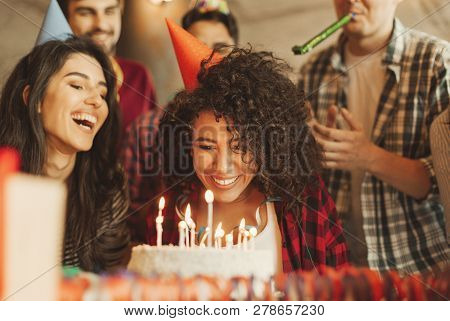 poster of Excited Girl Ready To Blow Out Candles On Cake On Birthday Party With Happy Friends. Happy Birthday