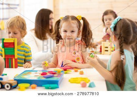 Group Of Preschool Children Playing