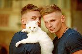 Perfect Furry Friend. Cat Is A Part Of Their Family. Muscular Men With Cute Cat. Happy Cat Owners On poster