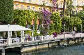 Lake Garda, The Largest Lake In Italy, View Of The City From The Lake, Boulevard With Typical Vegeta poster