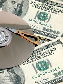 A hard drive platter surrounded by money. Signifying the high cost of storage and bandwidth poster