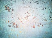 Close-up Detail Of Cracked Paint On Rusty Metal Wall. Cracked Painted Old Metal Texture. Turquoise C poster