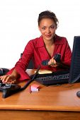 pic of pick up  - Beautiful female executive picking up a telephone call  in the office - JPG