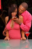 African American couple in a martini bar sharing a Martini