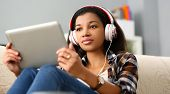 Black Ordinary Female American Teen Portrait At Home Sofa Remote Education Concept. Girl Hold Tablet poster