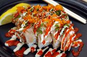 Tataki Special Sushi Roll. Spicy tuna in sushi rice with seared albacore, chopped onions, smelt roe, chili and mayonnaise sauce