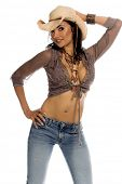 Picture of super sexy rodeo cowgirl in torn jeans and a straw cowboy hat.