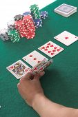 Texas Hold 'Um poker player peels back her cards to reveal a hearts Royal Flush Generic no label card backs from China