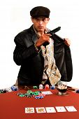 Mexican man playing Texas Hold um Poker stands up and draws a pistol out of his leather coat as the game goes bad