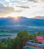 Scenic Sunset Landscape With Pai Village In Mountains Valley, Thailand poster