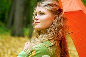 girl and orange umbrella