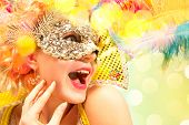 Beautiful Surprised Woman In Carnival Mask. Beauty Model Woman Wearing Masquerade Mask At Party Over poster