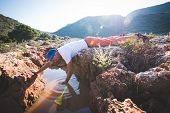 Exhausted Adventurer Drinks Water From A Crevice In A Rock poster